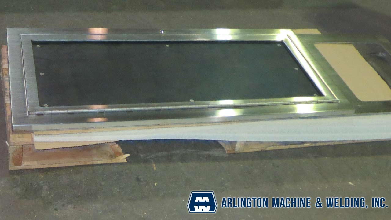 Stainless steel kiosk doors fabricated by Arlington Machine & Welding Inc.