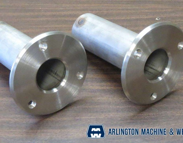 Stainless steel handrail stanchions fabricated by Arlington Machine & Welding Inc.